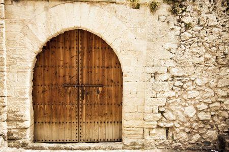 Old wooden door from medieval era. Stock Photo