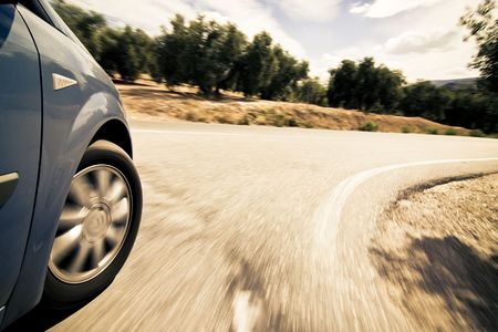 cruising: Turning wheel at high speed in the countryside. Stock Photo