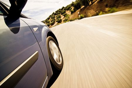 cruising: Blue car cruising the countryside at high speed Stock Photo