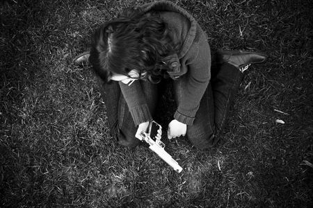 Young sad girl in the floor after killing photo
