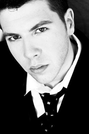 Staring businessman in dark black and white. photo