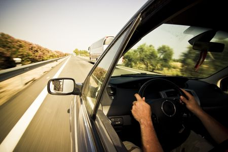 cruising: Cruising the highway at high speed. Stock Photo