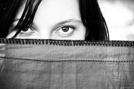 Young woman looking at camera behind veil. Stock Photo - 3431728