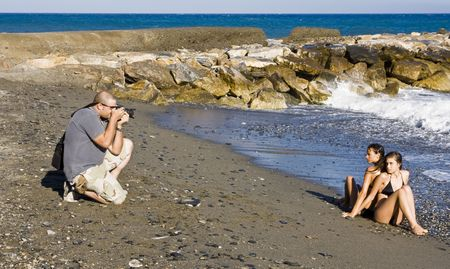 Photographer and models in summer photoshooting photo