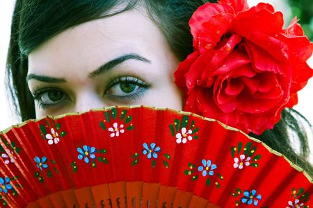 Spanish woman behind traditional fan. Stock Photo