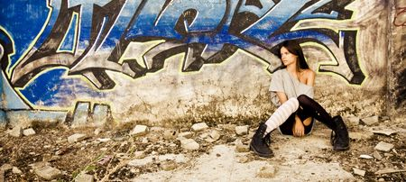 Rebel young girl sat in a dirty place. Stock Photo - 3512062