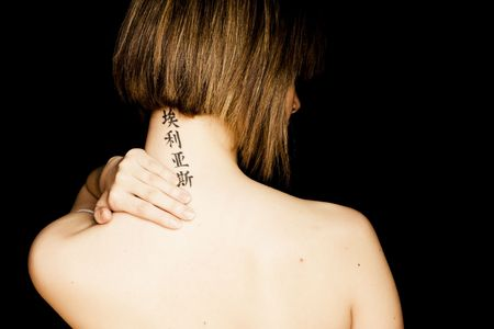 short back: Short haired woman with asian tattoo in her neck feeling pain.
