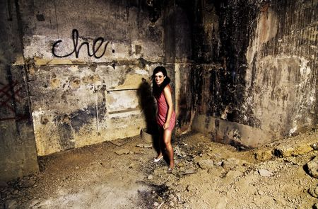 psyco: Mad young woman in a dirty place Stock Photo