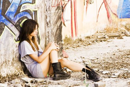 vandal: Young sad woman in casual clothing.