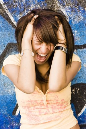 Screaming young woman over blue background Stock Photo - 3538137