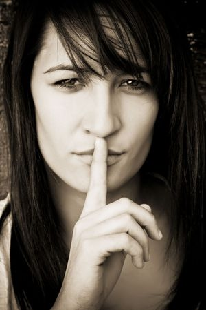 Young woman requesting silence, sepia toned. Stock Photo - 3538100