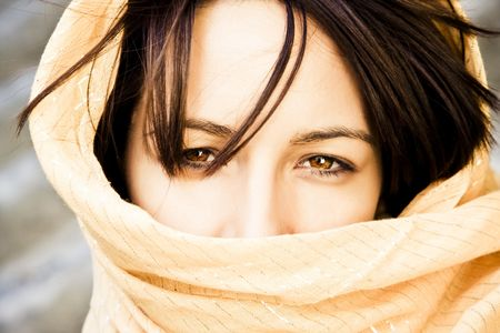 Young green eyed woman behind veil.