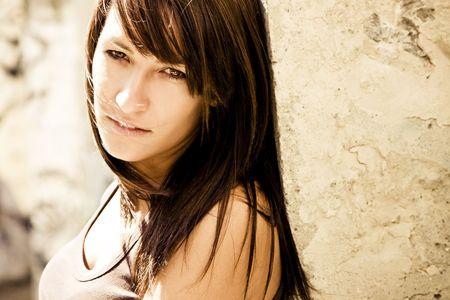 Beautiful woman on wall staring at camera. Stock Photo - 3538115