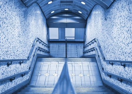 subway entrance: Subway entrance with blank panels, blue toned.