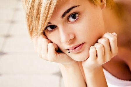 Young beautiful blond woman staring at camera photo