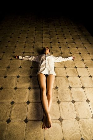 faithfulness: Young seminude crucified woman on the floor