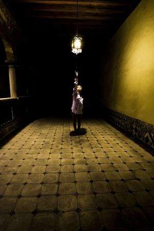 Young woman in spooky corridor photo