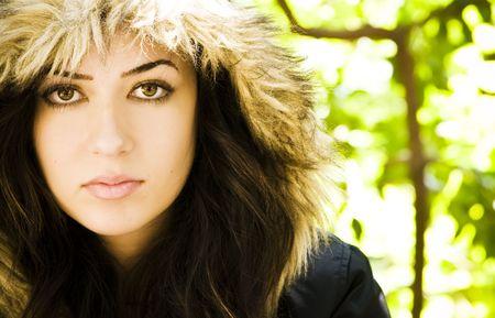 Woman portrait wearing a fur cap. photo