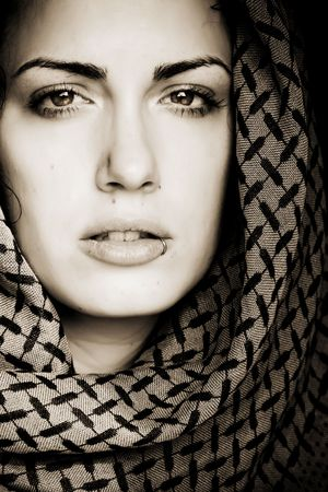 veil: Arab woman using veil with her mouth pierced.