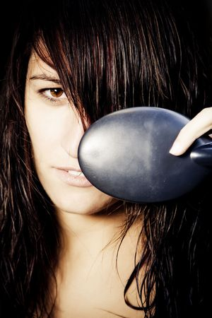 tormented: Young woman portrait brushing her long hair. Stock Photo