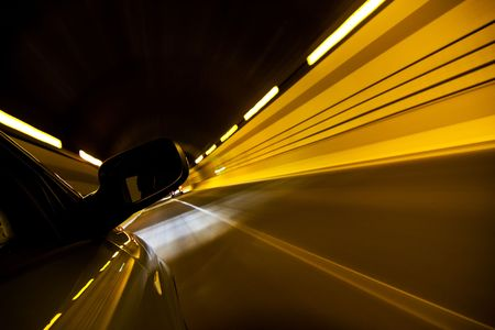 Driving fast inside tunnel photo