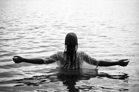 Young woman with raised arms in the water. Black and white. Stock Photo - 3676671