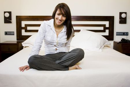 Long haired businesswoman resting in bed. photo