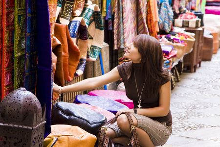 Woman shopping in muslim styled market photo