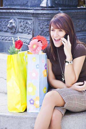 Cheerful young woman having a great tome at phone. photo