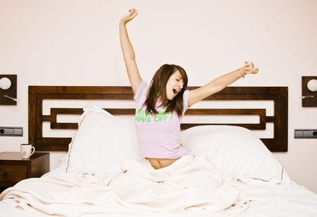 Young beautiful woman waking up in the morning Stock Photo - 3830679
