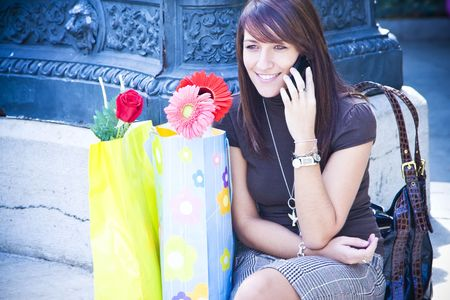 Cheerful young woman having a chat at phone. photo