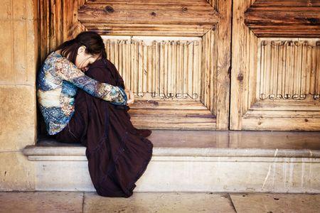 Sad elegant woman sitting and crying photo