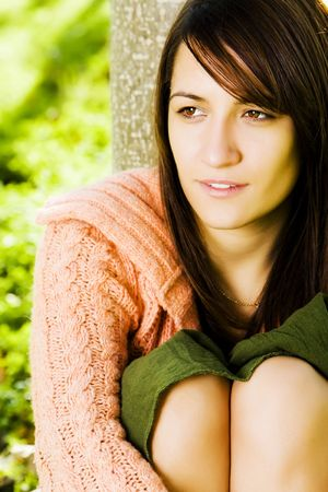 Young beautiful woman posing in a forest. photo
