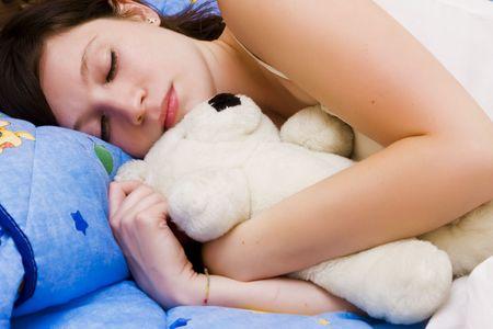 Beautiful sleeping girl with her teddy bear. Stock Photo - 3889892