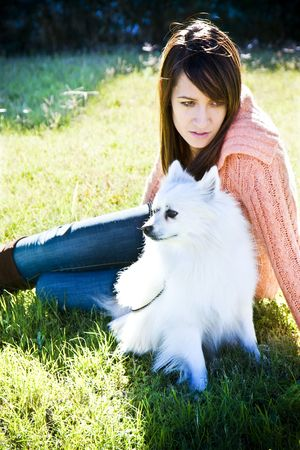 Young beautiful woman with her pet in the park. Stock Photo - 3900121