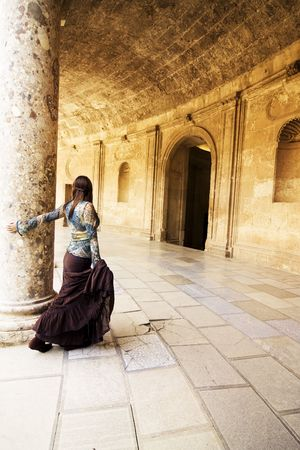 marble palace: Young beautiful woman posing in ancient corridor