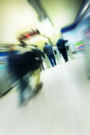advancing: Blurred advancing people through transport installations Stock Photo