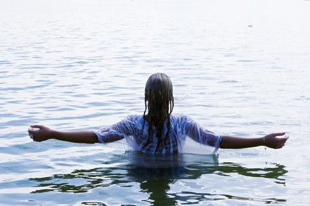 Young woman with raised arms in the water. Stock Photo - 3993056
