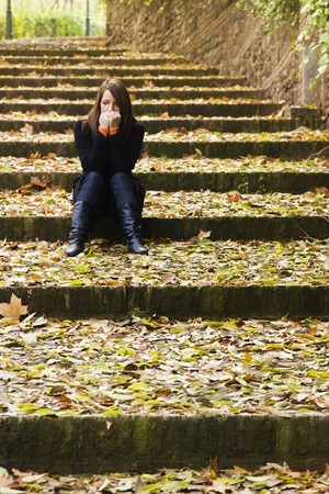 worried: Young lonely beauty in autumn background