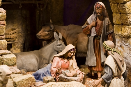 figurines: Nativity scene from figurine crib. Focus on Mary and baby Jesus.
