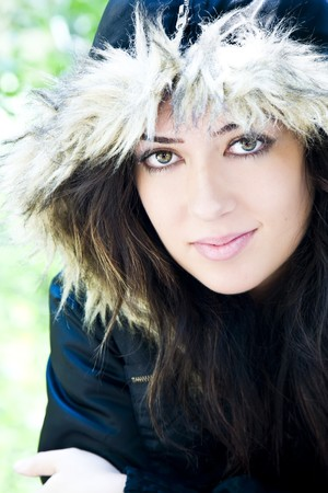 Woman portrait wearing a fur cap. photo
