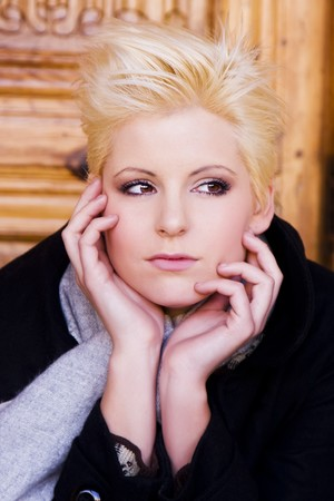 Thoughtful young short haired blond woman photo