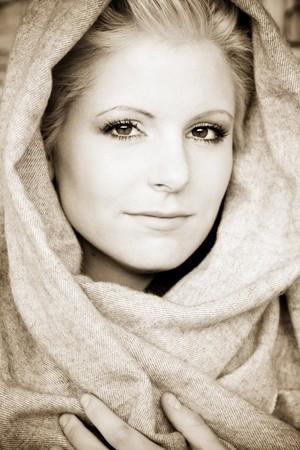 Young beauty wearing arab veil, sepia toned. photo