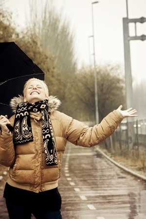 Happy young blond woman in a rainy day. Stock Photo - 4084751