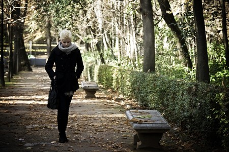Young woman taking a walk in the park. photo