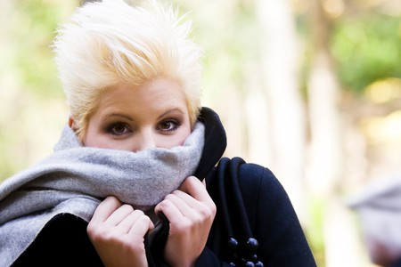 Cheerful woman in cold gesture photo