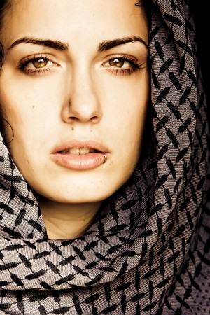 handkerchief: Arab woman using veil with her mouth pierced.