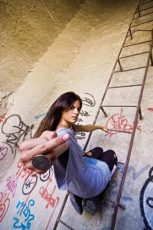 Young rebel girl gesturing at camera. photo