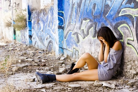 sexual abuse: Young sad woman in casual clothing Stock Photo