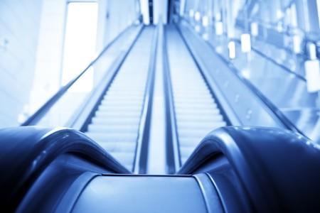 Two ways escalator in blue tone. photo